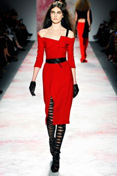 Lovely angular neckline—the rare moments of bright red in this collection are played up for maximum effect—all shape, no texture aside from the folds and layers of fabric, and a sharp obi belt. I do hope the obi belt trend continues. #prabalgurung #nyfw