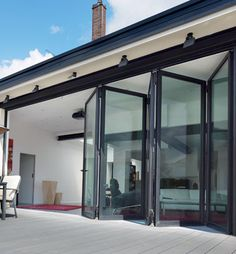 For an open an airy feel folding sliding glass doors are a must for slim frame bifold doors can provide an innovative and smart way to link a home effortlessly planetlyrics