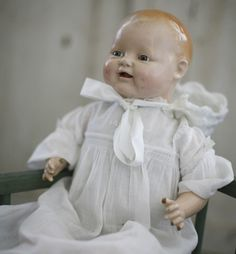 Old doll.  My Gran used to let me play with her doll like this one.  It had four little front teeth made of porcelain or something similar:)