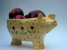Ceramic pig bowl chockful of apples