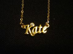 Janet Weiss: Name Necklace - Kate - Gold Tone - The Rocky Horror Picture Show