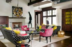 Eclectic living space with a vibrant palette on a white canvas with lots of whimsical fun thrown in the mix.  Cheery & unique.