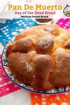 Pan de Muerto or Day of the Dead Bread is a light and tender sweet Mexican bread flavored with anise seeds and orange zest. This Pan de Muerto recipe is easy to make, delicious and the best centerpiece for all your Day of the Dead celebrations. #diadelosmuertos #HalloweenTreatsWeek #LemonBlossoms #baking #bread #Halloween #Mexicanrecipe #sweetbread