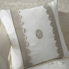 Cream broderie Anglaise monogram cushion cover with pleated and lace trim. Very simple and so very pretty. A lovely shabby chic addition to your home. Tie fastening on reverse. All our monogram cushion covers now come with 50cm poly pad insert…A massive saving of £3.95