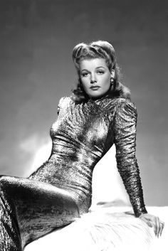 21. Ann Sheridan, 1942 Ann works the metallics trend in this decadent high-neck gown.