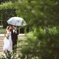 couple walking with umbrella rainy day wedding