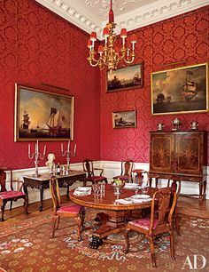 Coral-red silk-wool damask dominates a dining room at Easton Neston, fashion designer Leon Max's historic house in Northamptonshire, England. Ptolemy Dean Architects Ltd. restored the house, while its rooms were decorated by Spencer-Churchill Designs Inc. Architectural Digest, Jewel Tone Room, Jewel Tones, Room Inspiration, Design Inspiration, Casual Dining Rooms, Damask Wallpaper, Room Wallpaper, Red Rooms