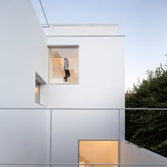 New apertures and an all-white stairwell are among the modifications made by Argentine studio Alonso & Crippa to a two-storey, century-old brick building in a gentrifying district in Buenos Aires.