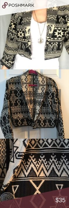 Vintage Aztec cropped jacket Black and cream vintage cropped Aztec jacket is prefect for the trendy edgy girl! It has wide sleeves and a single button front. A ribbon trim along the bottom of the jacket and around the sleeves. Sleeves can be rolled up to expose the cream pattern for a little contrast. Beautiful jackets with no flaws in prefect vintage condition. There is no tag but it's a size medium. Measurements soon. No Brand  Jackets & Coats