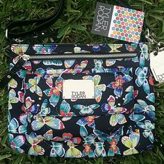 """Tyler Roldan Butterfly Spring Colors Crossbody Bag Brand new with tags  MSRP $68 plus tax   Gorgeous colorful butterflies! So spring ready!  3 exterior pockets,  interior compartments,  Top zippered closure.  Adjustable strap.  Keychain on the side.   Measurements L 10.5"""" x H4.5 8.5"""" x W 2"""" Tyler Roldan  Bags Crossbody Bags"""