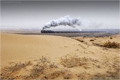 The Desert Song  The delights of the Da-Gu, or Desert Line as it was known. Easy to see why, with QJs working trains through the sand dunes near the top mine. I only made just the one visit sadly, and it hardly ever stopping sleeting or snowing during our two days there, but that's not necessarily a bad thing. Ningxia Province, central China. January 2006. © David Hill.