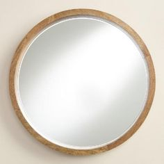 A subtly flared profile enhances the depth of our round mirror, handcrafted of natural wood with inherent variations that make each piece unique. Pair two together to double your style statement.