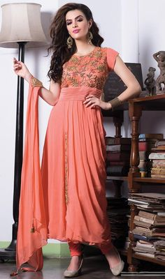 Decode your fashion statement as you step out in this designer tomato embroidered georgette churidar suit. You are able to see some intriguing patterns done with floral patch, lace and resham work. #NewFashionOfDesignerWear