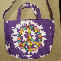 2 Hippie Tie Dye Cotton Tote Bags Price is for 2 cotton totes! They're a fairly large size. Great for a funky purse ;) Great condition, barely used. Bags Totes