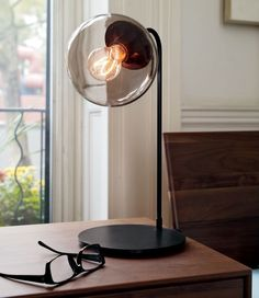 Captivating The Modo Table Lamp Is A Bit Playful In Its Design With A Tinted Glass Globe