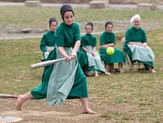Amish girls play softball after class in Bergholz, Ohio, April 9, 2013.