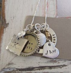 The Michele Family Custom Hand Stamped Necklace by zbet on Etsy.  Love the look of this necklace :)