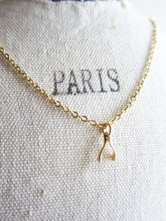 In Paris, A Wishbone Necklace On Gold Chain Simple Everyday Casual Necklace by Jewelsalem