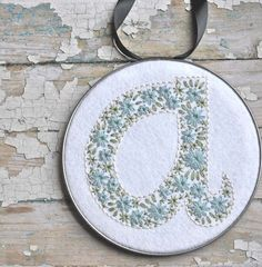 Stunning embroidery in this: Hand Embroidered Wool Felt Initial A Hoop Art in Next Time Won't You Sing With Me pattern