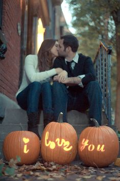 This couple chose to express their love via pumpkins during their engagement session by carving words into each. You can use the same concept to direct your guests around your reception, lighting the way to the welcome table or buffet.