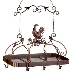 Attractive overhead rack puts your pots and pans right within easy reach; a must-have for any serious chef! Jaunty rooster and scroll work theme and rich rust-red finish add informal elegance to your