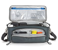 Front zippered pocket catch-all for batteries, memory cards, cables and small accessories
