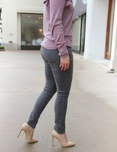 Houston Style Blogger wears a winter outfit idea featuring gray skinny jeans, a pastel purple sweater with ruffle sleeve details. Click through for outfit details.