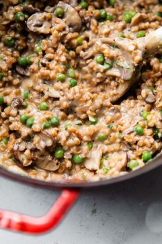 Mushroom Farro Risotto - this easy dinner recipe provides a healthier twist on classic risotto! Creamy bursting with hearty mushroom and fresh herb flavor this risotto recipe uses my favorite no-stir cooking method. Just before serving we'll stir in thawed peas for a touch of color and natural sweetness! #abeautifulplate #recipe #risotto #farro #dinner #easydinners #cookingmethod #cooking #method
