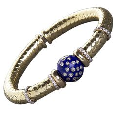 Woven Gold Lapis Lazuli and Diamond Bangle | From a unique collection of vintage bangles at http://www.1stdibs.com/jewelry/bracelets/bangles/