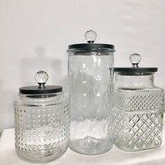 Beautiful 3 piece canister set with unique clear textured glass. Versatile for use in many styles of home from boho to modern contemporary. This set includes 3 canisters, wood lids, and choice of knob.These are larger capacity jars. White Canister Set, Glass Texture, Rustic Kitchen Canisters, Urban Rustic, Rustic Canisters, Glass Canister Set, Glass, Rustic Kitchen, Modern Contemporary