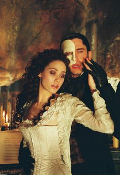 The Phantom of the Opera (2004) A disfigured musical genius, hidden away in the Paris Opera House, terrorizes the opera company for the unwitting benefit of a young protégée whom he trains and loves.  #movie