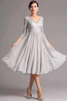 This vintage lace and chiffon homecoming prom dress comes with a V neck and 3/4 sleeves. The silver tea length dress is suitable for any special occasions!