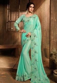 Product ID: Work Type: Zari, Thread Embroidery, Cording, Stones & Sequins Work Saree Color: Turquoise Blouse Color: Turquoise Saree Fabric: Satin Silk Blouse Fabric: Art Silk Saree Size: Metres Blouse Piece Size: Ethnic Looks, Embroidery Saree, Art Silk Sarees, Designer Sarees Online, Traditional Sarees, Party Wear Sarees, Printed Sarees, Indian Ethnic Wear, Embroidered Silk