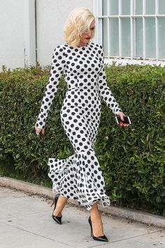 Gwen Stefani attended a meeting in Santa Monica wearing a long sleeve polka dot midi dress with a ruffle hem and Christian Louboutin So Kate pumps