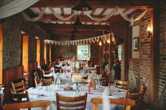 lovely antique pub-warehouse wedding reception setting The draping fabric is a nice touch