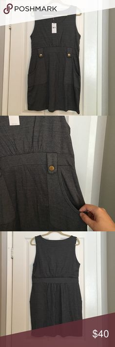 Grey Sleeveless Dress with Pockets NWT. Material has stretch to fit XXL as well. Two front pockets with Gold Button detail. Approx 20 in from waist. Very well made and great for your work wardrobe! Dresses