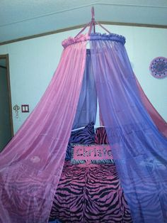 Bed canopy made from a hula hoop and curtains