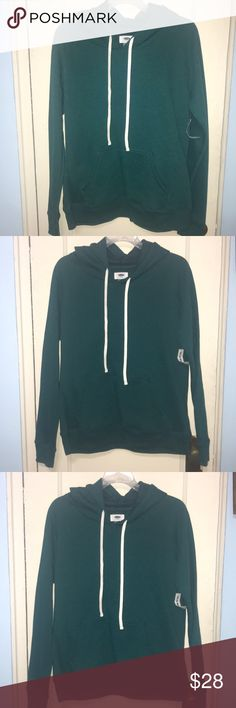 🆕 Old Navy Green Hoodie Sweatshirt M can fit S 🆕 Old Navy Green hoodie sweatshirt . It is fitted the sweatshirt more in my opinion. I went up in size in it from small to medium .  Measurements listed below .  25 in length  Arm to arm flat 20 inches  Made in Cambodia Old Navy Tops Sweatshirts & Hoodies