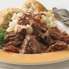 Make ribs the easy way in your slow cooker with this delicious tomato-wine sauce. Short Ribs Slow Cooker, Crock Pot Slow Cooker, Crock Pot Cooking, Slow Cooker Recipes, Cooking Recipes, Crockpot Dishes, Pork Dishes, Crockpot Meals, Rib Recipes
