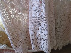 Here is a beautiful vintage hand crocheted ecru cotton lace tablecloth bedspread or throw Done in medium crochet thread in an motif