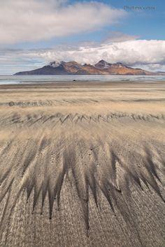 Isle of Eigg. Laig Beach sand patterns, view to Rum. Small Isles. Scotland.