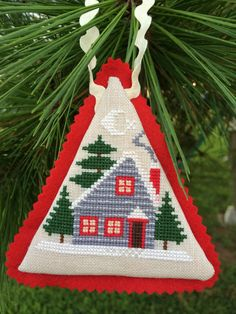 Cross-stitched Christmas Cabin Ornament by hjdunagan on Etsy