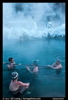 People with frozen hair relaxing in hot springs. Chena Hot Springs, Alaska, USA