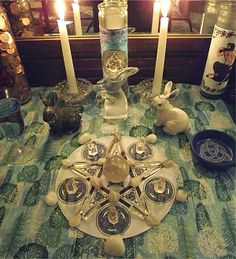 Snow Moon altar for the full moon. I'm not sure about the rabbit symbolism, but I like the tree patterned altar cloth and LOVE the crystal/stones pentacle setup.
