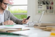 Stockfoto : Interior designer using a mobile phone in the office