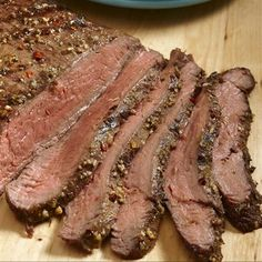 Traditional flank steak gets an island twist with pineapple, a hint of lime, cumin and crushed red pepper. #recipe