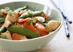Spring Stir Fried Chicken with Sugar Snap Peas and Carrots – Spring vegetables and chicken breast strips sauteed with fresh ginger, lime juice, and a touch of soy sauce for a quick weeknight meal.