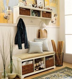there's alot that I love about this.  storage, baskets, seating, beadboard, map wall paper, sea inspired