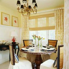 According to BH&G, when decorating a small dining room, you can visually raise a low ceiling by covering the bottom two-thirds of the walls with beadboard or decorative panel, read more at homecraftsdiy.com