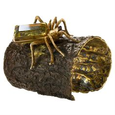 Wynn Wynn Ong's rustic 'All Bark, Some Bite' brass cuff holds a hand-sculpted spider with faceted Brazilian tourmaline eyes and a 94.6-carat emerald cut Brazilian citrine belly